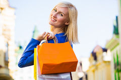 Sale, shopping, tourism and happy people concept - beautiful woman with shopping bags in the ctiy Royalty Free Stock Images