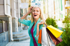 Sale, shopping, tourism and happy people concept - beautiful woman with shopping bags in the ctiy royalty free stock photography