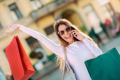 Sale, shopping, tourism and happy people concept. Beautiful woman with shopping bags in the city Royalty Free Stock Image