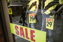 Sale in shopping window of clothes store Stock Image