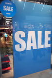 Sale in shopping wndow of fashion store Stock Photo