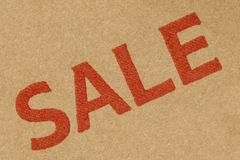 Sale Sign. Background from a cardboard box Stock Images