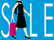 Sale Sign. With walking lady carrying shopping bag Stock Photo