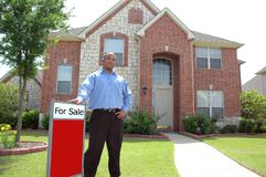 For Sale Sign. Man stands outside of home for sale. This could be buyer, seller, realtor or renter. For Sale at top, below blank box for text Stock Photography