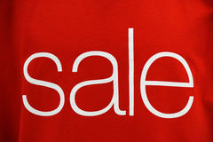 Sale sign. Word sale on textile texture Royalty Free Stock Image