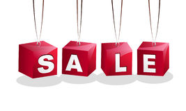Sale sign. Four cubes forming sale sign hanging on strings Royalty Free Stock Photos