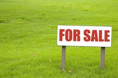 For Sale Sign. On an empty piece of land Stock Photography
