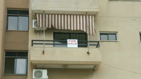 For sale sign on apartment balcony. Real estate agency services. Debt crisis. Stock footage stock video