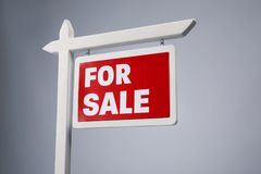 `For sale` sign on background. `For sale` sign on grey background royalty free stock image