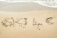 Sale sign on the beach Stock Photography