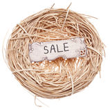Sale Sign in a Birds Nest Royalty Free Stock Image