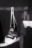Sale sign. Black and white sneakers, cap  hanging on clothes rack   background.   friday. Close up. Royalty Free Stock Images