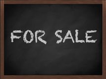 For Sale sign on blackboard. For Sale chalk letters on a frame blackboard Stock Photos