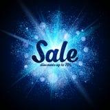 Sale sign on blue glitter cosmic splash at dark Stock Image