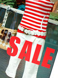 Sale sign on boutique window royalty free stock photos