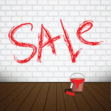 Sale sign on a brick wall Royalty Free Stock Photos