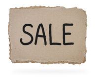 Sale sign on cardboard. Stock Photos