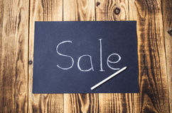 Sale sign on chalk board with chalk Royalty Free Stock Photos