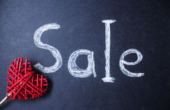 Sale sign on chalk board with red handmade heart Royalty Free Stock Photos