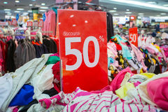 Sale sign in the clothing shop Royalty Free Stock Photo