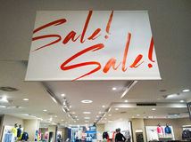 Sale sign. A sale sign in a clothing store Royalty Free Stock Images