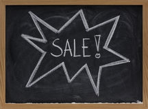 Sale sign concept on blackboard Stock Photography