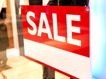 Sale sign with copy space in a shop window Stock Photos