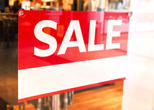 Sale sign with copy space in a shop window Royalty Free Stock Photo