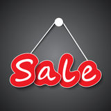 Sale sign on dark background Royalty Free Stock Image