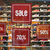 Sale sign and discount numbers on shop window Royalty Free Stock Photos