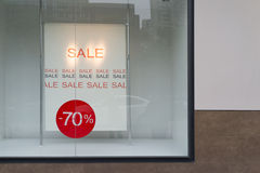 Sale sign. In a fashion shop window Stock Photos