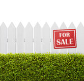 For sale sign on the fence. For sale sign on white wooden fence isolated on white background with copy space Royalty Free Stock Image