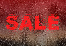 Sale sign on frosted window Royalty Free Stock Image