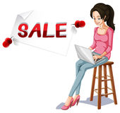 Sale sign and girl typing on computer Royalty Free Stock Image