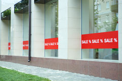 Sale sign on glass window stock photos