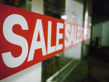 Sale Sign On Glass Window Royalty Free Stock Images