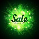 Sale sign on green glitter cosmic splash at dark Royalty Free Stock Photos