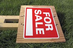 For Sale Sign on Green Grass. With blank telephone number Royalty Free Stock Photos