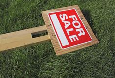 For Sale Sign on Green Grass Stock Photo