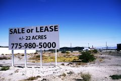 For sale sign grounds in the South Strip in Las Vegas. A for sale sign grounds in the South Strip in Las Vegas, Nevada, on Oct 26, 2015. Las Vegas Royalty Free Stock Photos