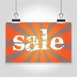 Sale sign hanging on the clamps Stock Image