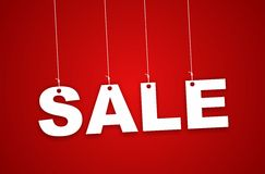 Sale Sign haning with ribbon Royalty Free Stock Image