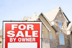 For sale sign and a house Stock Image