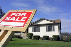 For Sale Sign House and Green Grass Stock Photo