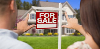 For Sale Sign, House and Military Couple Framing Hands Stock Image