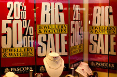 Sale sign in a jewellery shop window. Signage in a jewellery shop window in New Zealnd advertising big discounts stock images