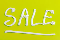 Sale sign on a light green background Stock Photos
