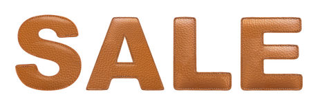 Sale sign made of leather. Letters s a l e made of stitched leather isolated over white background. Orange color. Frontal view stock images