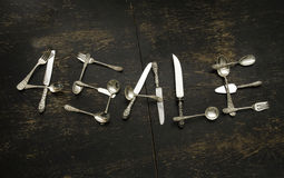 For Sale sign made of sterling silver flatware Stock Images