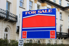 For sale sign outside old house Royalty Free Stock Images